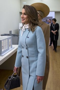 In a stylish light blue woollen coat, Rania looked impressed by the Dutch art on display...