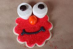 Elmo Cookies - decorated with red sprinkles, orange peanut M, brown Reese Pieces and marshmallows