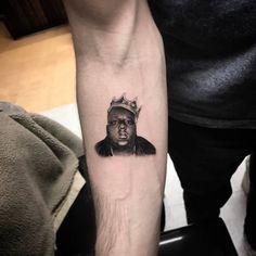 Single needle Notorious B.I.G portrait tattoo on the right inner forearm. Tattoo Artist: BooBoo · Isaiah Negrete