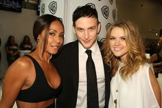 GOTHAM stars Jada Pinkett Smith (left), Robin Lord Taylor and Erin Richards at the Warner Bros. booth at Comic-Con 2014. #WBSDCC