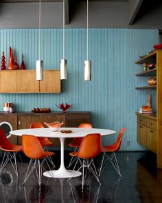 Mid Century interior with orange #Eames shell chairs and #Saarinen Tulip Table--by Laurie Rubin Photography.