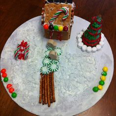 Gingerbread houses using graham crackers over a mini milk carton and a sugar cone for the tree!!!!  Love it!!!!