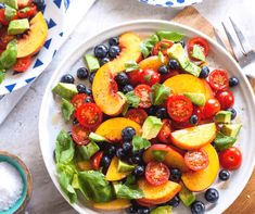 This isn't your typical fruit salad. Made with peaches, tomatoes, avocado & blueberries this fruit salad is worthy of the dinner plate!
