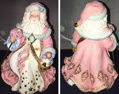 "The Danbury Mint Victorian Christmas  ""Santa Claus"" musical figurine plays ""Jolly Old Saint Nick"". Colors: Pink, Gold, & White. About 8 1/2"" tall."