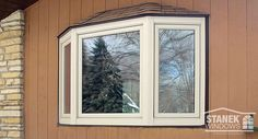 Three-lite bay window with shingled hip roof in beige. Learn more. Front Windows, Windows And Doors, Bow Windows, Bay Window Exterior, Vinyl Replacement Windows, Door Picture, Hip Roof, View Photos, Home Remodeling