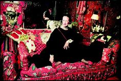 Diana Vreeland wearing her Bulgari enamel snake belt as a necklace while lounging in the famed Red Room of her New York City apartment - photographed by Horst P. Horst, 1979 #1970s #photography #fashion #bulgari #horst p. horst