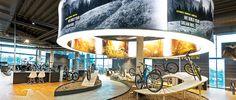 ROSE BIKETOWN Bocholt - Leidenschaft für das Radfahren   ROSE Bikes Bike Experience, Cool Bikes, Munich, Bike Shops, Ceiling Lights, Mansions, House Styles, Bicycles, Building