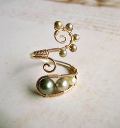 Green Pearl Wire Ring, Gold Filled Wire Wrapped Ring With Green Freshwater Pearls, Adjustable Wire Weave Ring. $45.00, via Etsy.