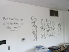 I think this a beautiful way to brand a wall in a charity office.  Stunning vinyl line art and lettering.