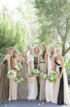 love the different bridesmaid dresses in the same color spectrum