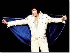 Elvis wearing the Blue Rain jumpsuit & cape. Nashville, TN. July 1, 1973.