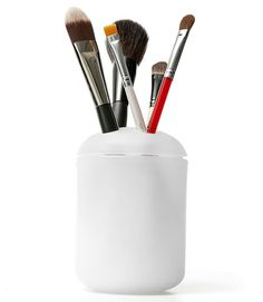 60 New Uses For Everyday Items ~ Use a toothbrush holder for your makeup brushes.