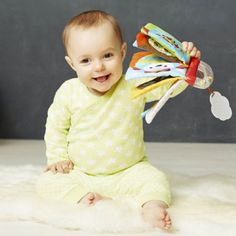 This soft activity book from Skip Hop's Explore & More line lets baby mix & match animal characters for endless play. With an easy-to-grab handle that doubles as a rattle, it features multiple developmental activities. Baby Mirror, Musical Toys, Bath Toys, Baby Safe, Mix N Match, Toddler Toys, Play, Book Activities, Educational Toys
