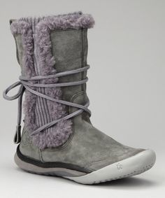 Beg for cool weather to rear its head when sporting these cozy boots. Warm lining, sleek waterproof suede and wool uppers and a molded rubber sole ensure that steps are as secure as they are trendy. 0.75'' heel8.5'' shaft14'' circumferencePull-onWate...