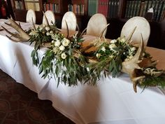 Loved using these red stag antlers for this game of thrones inspired wedding at Ettington Park.