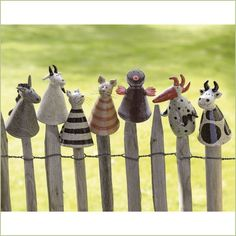 No source that I can find. Clay animals on a fence. Characters Charming.