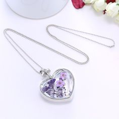 A crystal class necklace features heart shape pendant and romantic lavender in it.Perfect gift for ladies, girls, girlfriend, lover and wife. Shop Now>>> Heart Pendant Necklace, Pendant Jewelry, Beaded Necklace, Flower Necklace, Necklaces, Cheap Fashion Jewelry, Cheap Jewelry, Women Jewelry, Diy Jewelry