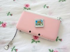 So recently I caved in and bought a Nintendo XL in pink/white. I also bought Animal Crossing: New Leaf . Animal Crossing, New Video Games, Metal Gear Solid, Girl Guides, Nintendo Ds, Cute Gif, New Leaf, Video Game Console, Girly Things