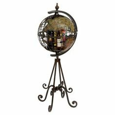"""Metal wine holder with open globe silhouette.Product: Wine holder Construction Material: MetalColor: Brown and greenFeatures: Holds up to four bottlesDimensions: 48"""" H x 20"""" Diameter"""