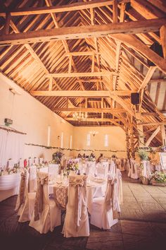 Rustic summer wedding flowers at Ufton Court, flowers created by Eden Blooms. Image includes jam jars, cream jugs, Olive Trees, apple crates of flowers and table plan flowers. Image by approved Ufton Court photographer http://www.helensarah.com/