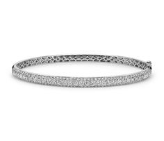 Let your style shine with this alluring bangle bracelet, highlighted by micropavé-set diamonds framed in 18k white gold.
