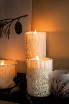 DIY Sweater sleeves wrapped around for cozy winter candle decor. I'm going to cut glass bottles and jars, smooth the top edge with my Dremel and reuse them for this idea!!