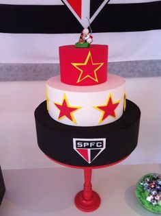 Soccer party black white and red cake