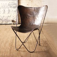 Natural, rustic Iron Sling Chair in Bronze | dotandbo.com