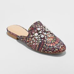 Whether you're looking to spruce up your collection of footwear or add the perfect finishing touch to a simple outfit, the Armina Backless Loafer Mules make an eye-catching choice. Classic slip-on mules get a colorful, fashion-forward update from an allover intricate pattern in varying jewel-toned hues, along with faux pearl and studded embellishments for extra spark. Pair them with a basic midi dress to give your look some extra charm, or add to boyfriend jeans and an oversized sweater f...