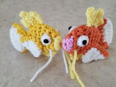 "Crochet a small standard pattern Magikarp of about 3.25"" long. Uses a red/orange yarn for the body, white yarn for tail and side fins, and yellow yarn for top and bottom fins."