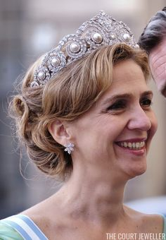 Infanta Cristina of Spain wears Queen Ena's Pearl and Diamond Tiara at the wedding of Crown Princess Victoria of Sweden in Stockholm, 19 June 2010