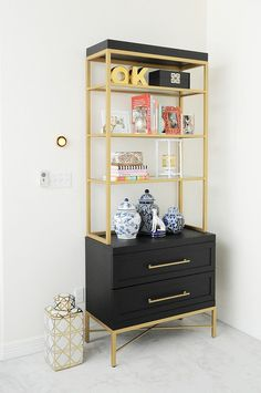 Chic & Easy Tips for Styling a Bookcase – Monica Wants It A gorgeous black and gold etagere styled with ginger jars, thrifted finds, chinoiserie decor and design books. Love the curated and chic look! Gold Furniture, Furniture Design, Coaster Furniture, Black Office Furniture, Asian Home Decor, Diy Home Decor, Muebles Home, Pink Home Accessories, Gold Etagere
