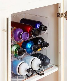 Water bottles can be tricky to store, so try organizing them on a wine rack!