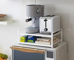 Microwave oven top shelving unit