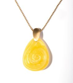 "Carved ""tear"" in yellow amber."