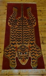 Tibetan Tiger Rug hand crafted from pure Tibetan wool by Tibetan refugees in Nepal.