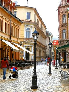 University Street in Kosice, Slovakia. Although not very long, you can easily feel the medieval history of this part of Košice. This is a back view to the Main street with Law School entrance gate to the left and Gymnasium entrance gate to the right.