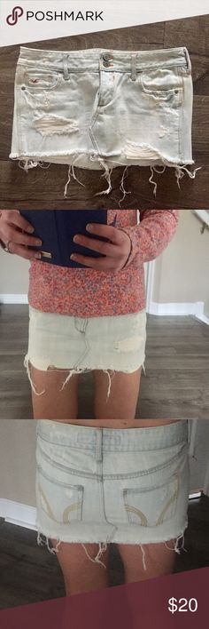 """Hollister very distressed mini denim skirt. Size 3 Light wash very distressed with rips and bleach spots. Only worn a handful of times. Length in front: 9.5"""" Length in back: 11.5"""" Hollister size 3 usually converts to a 2 ((posh wont let me pick 3 as the size)) Hollister Skirts Mini"""