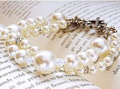 $58  Elegant bracelet with Swarovski pearls and crystals. This beautifully sparkling bracelet will dress up your wrist instantly!  Get this in my shop today.  RachelFlamDesign