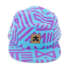 """Classic 5-panel snapback hat with bold all-over print """"X-Amount"""" inspired by African mudcloth textiles. Cotton canvas with brass puzzle piece logo. Available in Black/White, Black/Brown, and Sky/Purple.  Designed by AndreasOne of PEACEfits."""