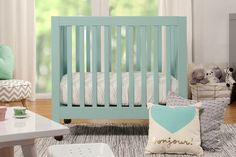 Have you ever considered a mini crib? They're so popular right now and are a great option for keeping Baby close.