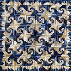 Shenandoah Log Cabin, designed by Judy Martin, made by Omaha Quilter's Guild for their 2012 opportunity quilt. The pattern is in Judy's book, Cookies 'n' Quilts.
