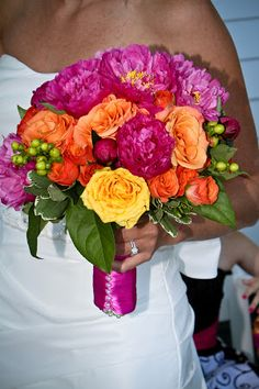 gorgeous bridal bouquet in fuchsia, orange and yellow for a summer wedding #bridalbouquet #weddingflowers