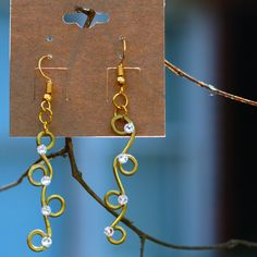 Handmade earrings for women with copper wire and Swarovski crystals. Order your pair today from bellatrixdelicate on Etsy #earringsforwomen #jewelry https://etsy.me/2EbvSKc
