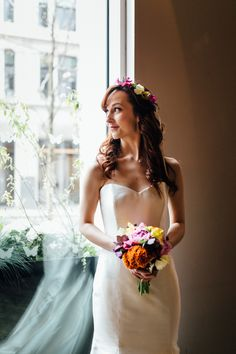 Colourful bohemian flower crown and small bouquet with a classic strapless wedding dress. Perfect wedding inspiration for a Spring/Summer wedding. Styling by Nulyweds, Photo by Beatrici Photography, Venue - The Anthologist Bar, Dress by Sassi Holford, Flowers by Okishima and Simmonds, Makeup by Debbie Purkiss, Hair by Tori Harris Pro Team