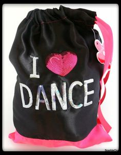 Your little dancer will love packing up her dance shoes in this cute shiny black and hot pink satin dance shoe bag. It's easy to open and close with a satin bow draw string. The I HEART DANCE applique is silver and hot pink sequins that sparkle.