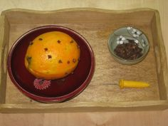 {winter} practical life idea.. cloves and oranges