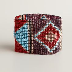 NOT a TUTORIAL, but I think this is reverse engineer-able Red and Blue Beaded Tribal Stripe Bracelet   World Market