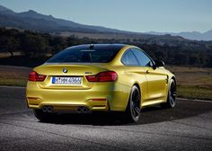 BMW M4 Coupe (2015) with quad exhausts.