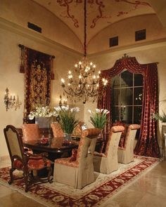 Like the bold red color accents, tapestry, and rug with neutral walls